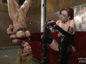 Госпожа извращенка подвесила рабыню и принялась пытать ее током